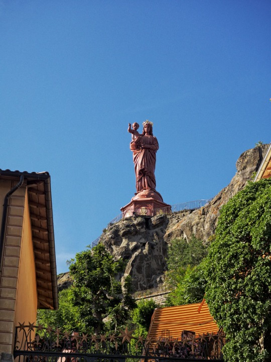 The iron statue of Notre-Dame de France (The Virgin Mary) overlooking the town of Le Puy