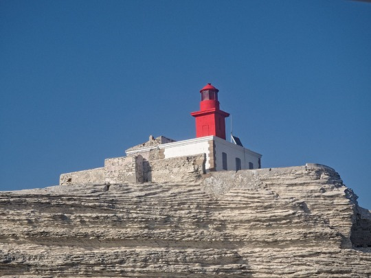 Lighthouse near Bonifacio while sailing, alternate view
