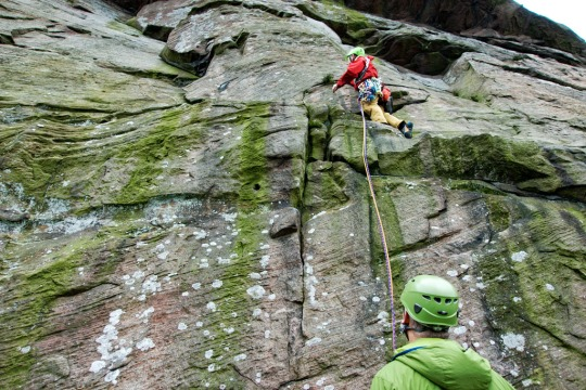 Richard climbing with Dave looking on, The Roaches England