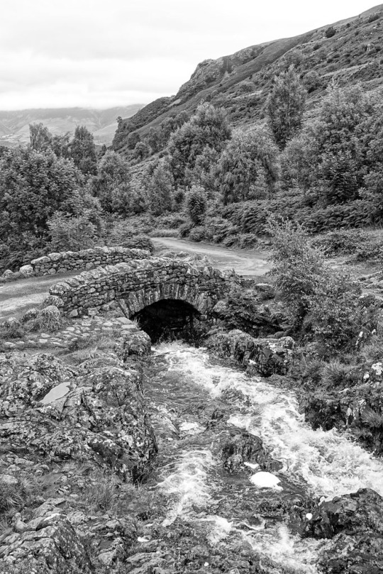 Black and white photo old stone bridge, The Lake District England