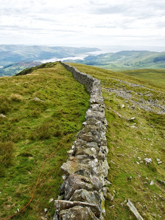 Stone wall that seems to go on forever, Wales