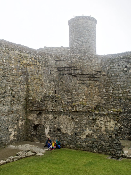 Family enjoying together time- Harlech Castle interior, Harlech Wales